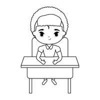 liten studentpojke som sitter i skrivbordet
