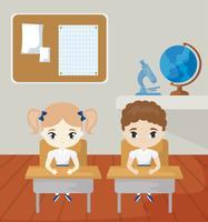 små elever i klassrumsscenen