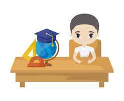 Studentenjunge, der in der Schulbank mit Versorgungsmaterialbildung sitzt