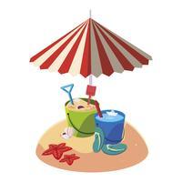 sommarsandstrand med paraply och sandhinkleksak
