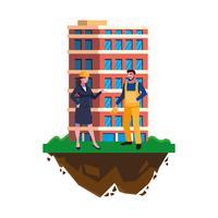 manlig byggmästare med kvinnaingenjör och byggnad