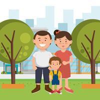Föräldrar och son i parken