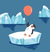 Pinguin hält Ballon auf Eisscholle
