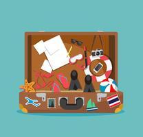 Öppen resväska för sommarsemester