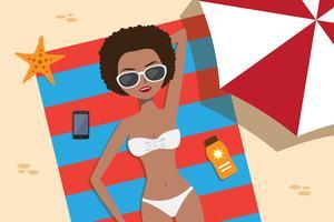 Flicka som kopplar av på stranden