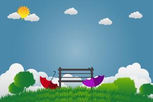 Två paraplyer och stol i en grön trädgård
