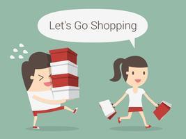 Fraueneinkaufen, während Mann Einzelteile trägt