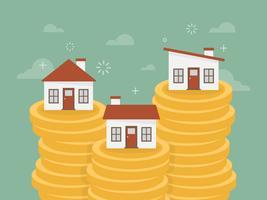 Häuser auf Stapeln von Münzen