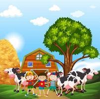 Barn och kor i gården