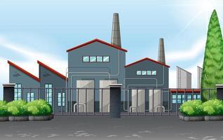Fabriksbyggnad bakom metallstaket