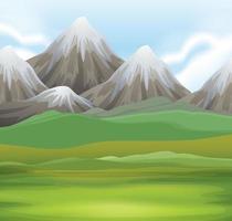 Naturscen av fält och snöklädda berg