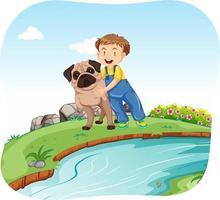 Liten pojke och hund vid floden