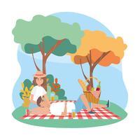 Par på filten på picknick vektor