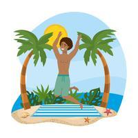 Man i baddräkt som hoppar på stranden