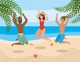 Grupp av olika män och kvinnor som hoppar på stranden