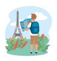Manlig turist som ser kartan framför eiffeltornet