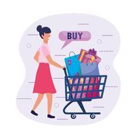 Frau mit dem Einkaufswagen voll von den Beuteln mit Kaufknopf