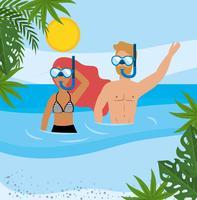 Kvinna och man som snorklar på stranden