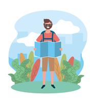 Manlig turist med solglasögon som rymmer kartan