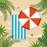 Flyg- sikt av paraplyet och handduken på sand