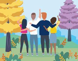 Grupp vänner som vinkar bakifrån i stadsparken