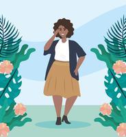 Afrikansk amerikankvinna parkerar med växter och blommor
