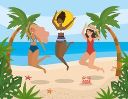 Grupp av olika kvinnor som hoppar på stranden