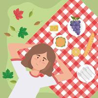 Flyg- sikt av kvinnan som kopplar av på picknickfilten