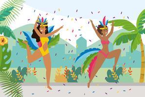 Kvinnliga karnevaldansare med konfetti utanför