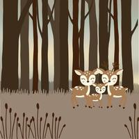 Söt hjortfamilj i skogen.