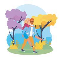 Junger Mann mit Gläsern ziehen sich in Park zurück