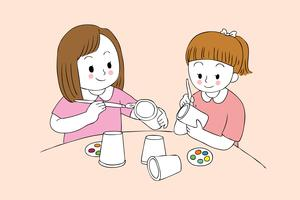 studentflickor som målar pappersglas
