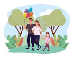 Söt förväntande par med dottern i park