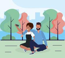 Söta par som tar selfie i park