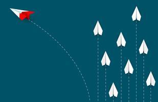 Ändernde Richtung des roten Papierflugzeuges vom Weiß vektor