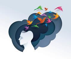 Menschlicher Kopf mit den bunten Vögeln, die vom Kopf fliegen