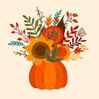 Herbstblumenstrauß im Kürbis