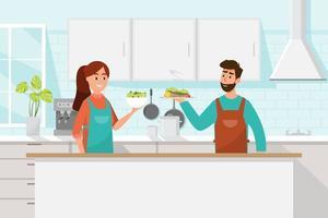Man och hustru lagar mat tillsammans