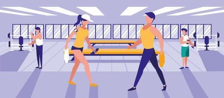 människor som gör övningar i gymmet