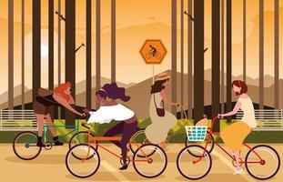 kvinnor som cyklar i skogslandskap vektor