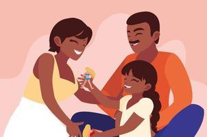 Mor och far med dotter som spelar