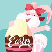 weibliches Kaninchen mit Ei von Ostern