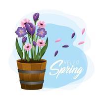 exotische Blumen mit Blättern im hölzernen Topf im Frühjahr
