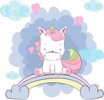 söt baby enhörning som sitter på regnbågen