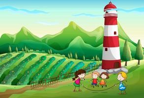 Kinder spielen auf dem Bauernhof mit einem Turm