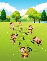 Apor som spelar hopscotch parkerar in