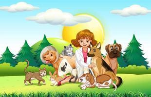 Kvinnlig veterinär och många djur