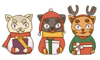 Söta katter för jul som rymmer julklappar vektor
