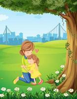 Eine Mutter umarmt ihre Tochter unter dem Baum