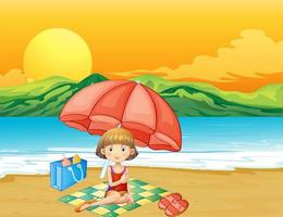 En flicka med en bok på stranden vektor